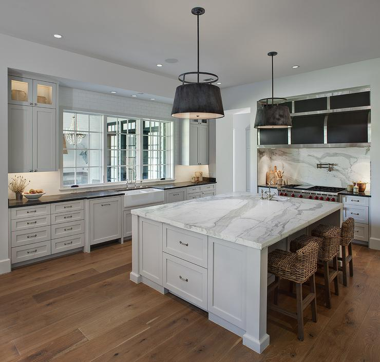Expansive Marble Top Island With Wicker Counter Stools