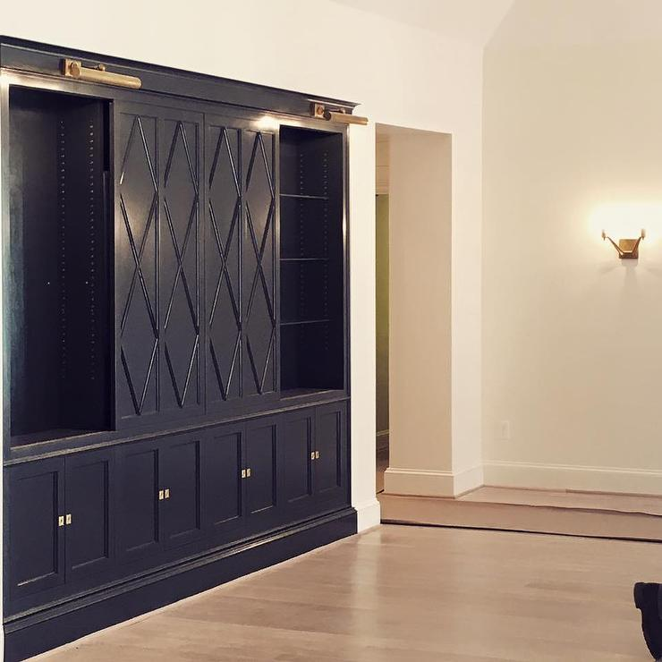 Navy Blue Cabinets with Diamond Pattern Sliding Doors Concealing TV & Navy Blue Cabinets with Diamond Pattern Sliding Doors Concealing ...