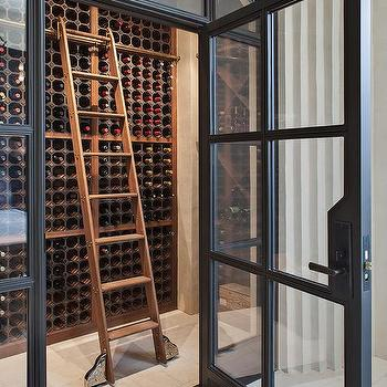 Steel and glass wine room design ideas wine cellar with wooden ladder planetlyrics Images
