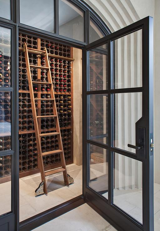 Wine Cellar With Wooden Ladder Transitional Dining Room