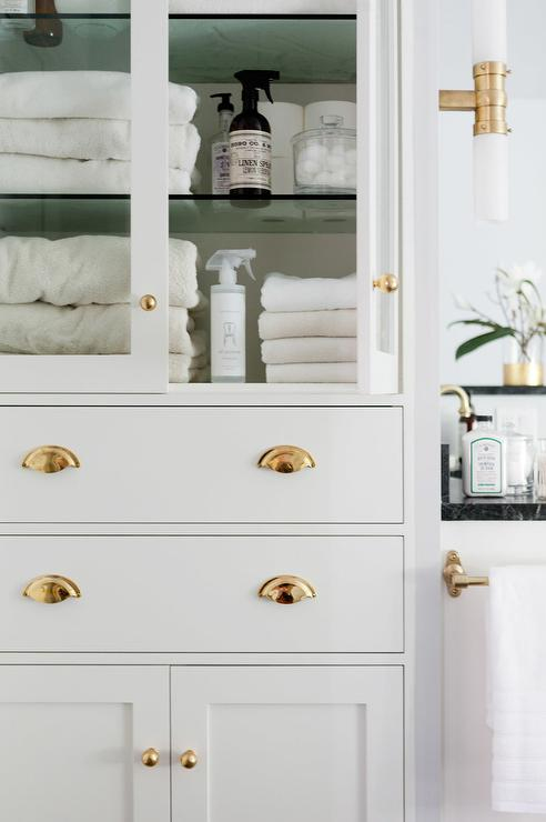 Glass Front Bathroom Linen Cabinet With Polished Brass