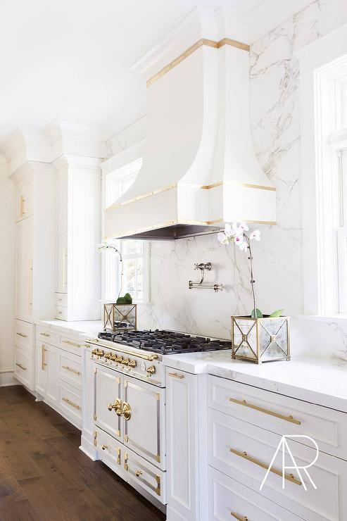 Alyssa Rosenheck: White And Gold Kitchen With Silestone Marble Like  Countertops