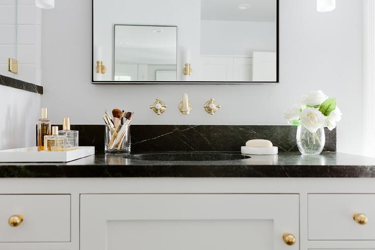 Black And White Bathroom With Soapstone Countertops And Wall Mount Vintage  Brass Faucet