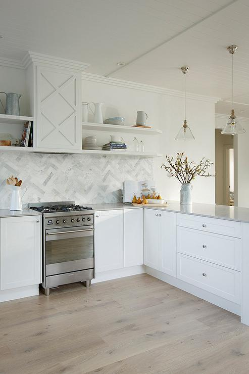 Beautiful Kitchen Features White Shaker Cabinets Paired With Light Gray Quartz  Countertops, Caesarstone Clamshell Quartz, And A Marble Herringbone ...
