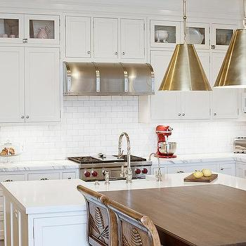 white shaker kitchen cabinets with mini subway tile