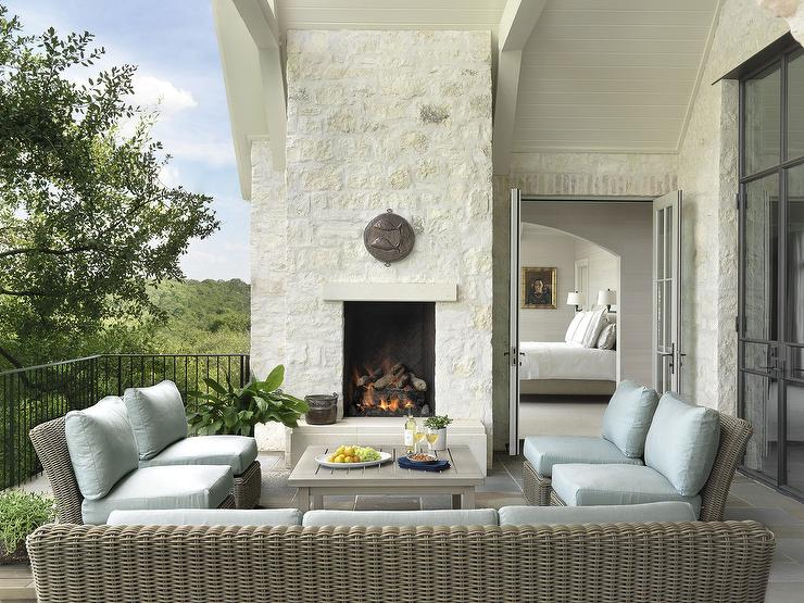 Second Floor Patio, Off Of Master Bedroom, Boasts A Gray Wicker Sofa And  Chairs Accented With Powder Blue Outdoor Cushions Facing A Gray Teak Coffee  Table ...