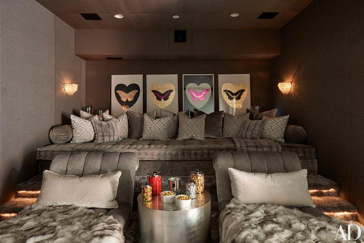 pink movie room with theatre seating hollywood regency