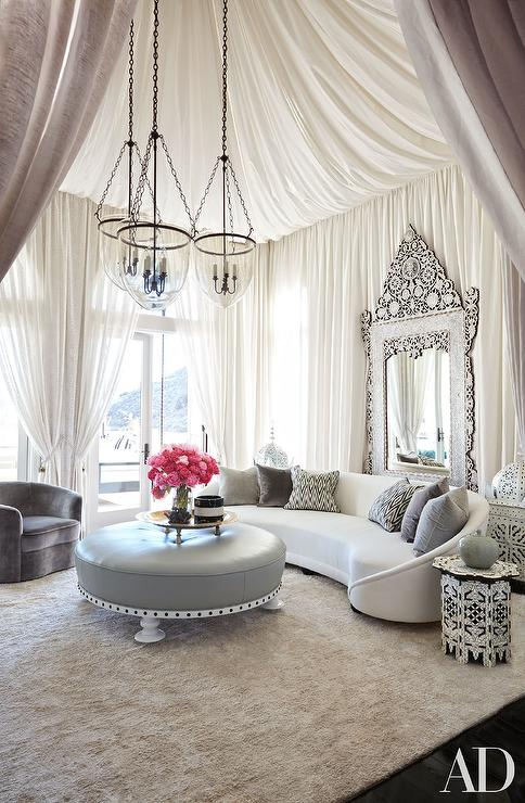 Hollywood Regency Style Living Room With Drapery Panels On Ceiling And Walls