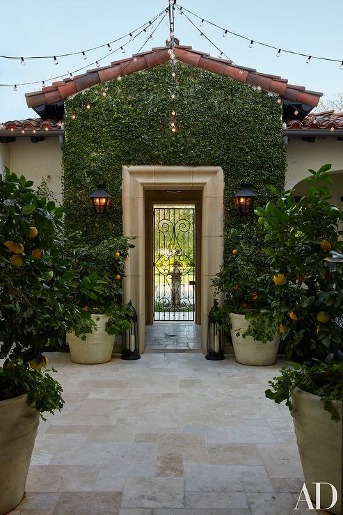 Mediterranean Patio With Potted Lemon Trees