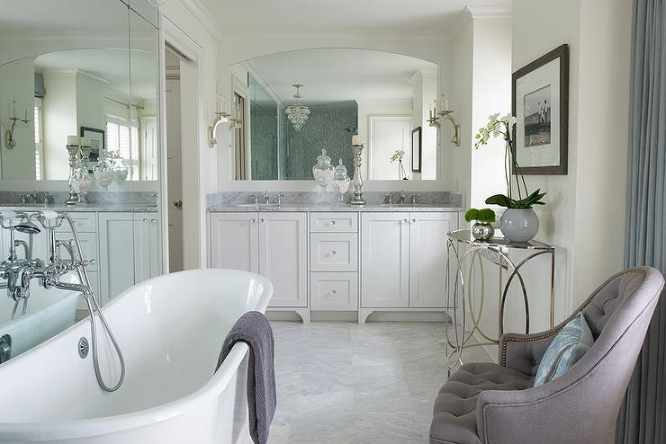 Vintage Freestanding Tub In Front Of Full Length Mirror
