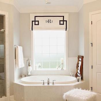 'Angled Tub with Black and White Monogram Roman Shade' from the web at 'https://cdn.decorpad.com/photos/2016/02/06/m_angled-tub-black-and-white-monogrammed-roman-shade.jpg'