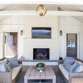 White Brick Outdoor Fireplace With Flat Panel TV Niche