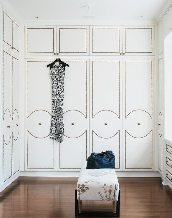 Walk In Closet With Upholstered Wardrobe Doors With Brass