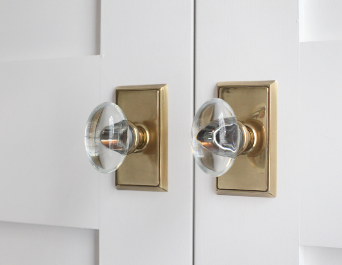 Pantry Doors with Brass and Glass Door Knobs