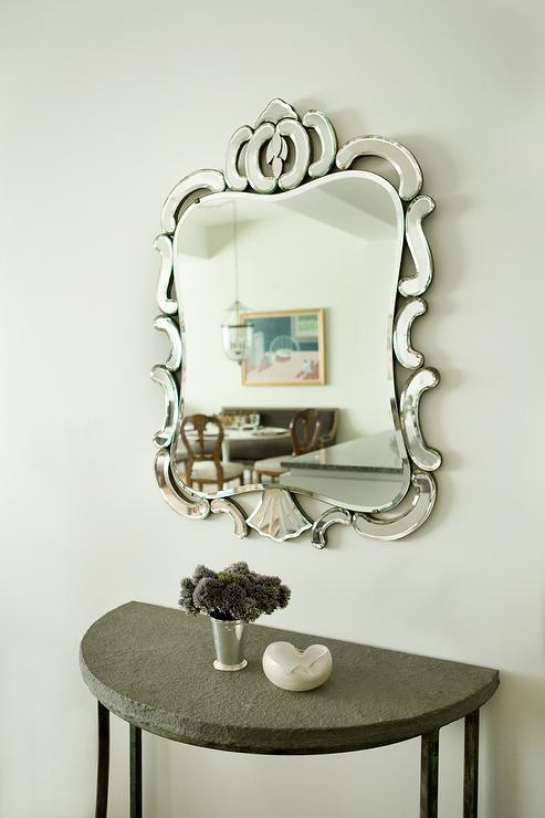Chic Foyer Features A Half Moon Iron And Concrete Console Table Under A  Mirror.