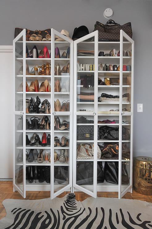 White Freestanding Shoe Cabinets With Glass Doors And Zebra Cowhide Rug