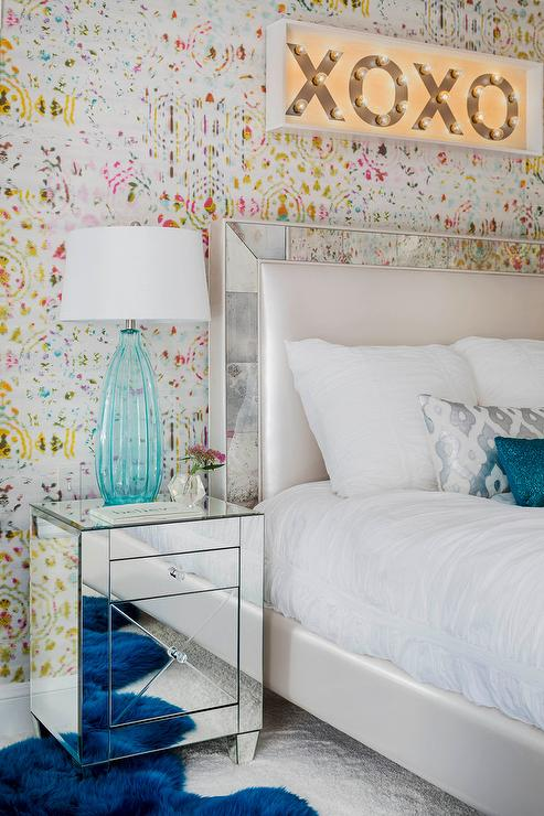 Chic teen girl s bedroom features walls clad in Kandy Brit Pop Wallpaper  lined with an XO marquee light over bed accented with a mirror framed  headboard. Teen Girls Room Design Ideas