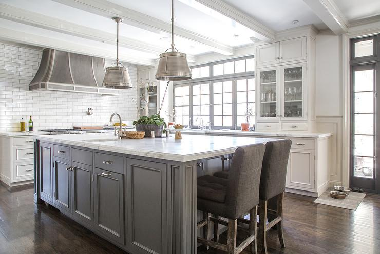 white kitchen island with gray velvet counter stools transitional kitchen