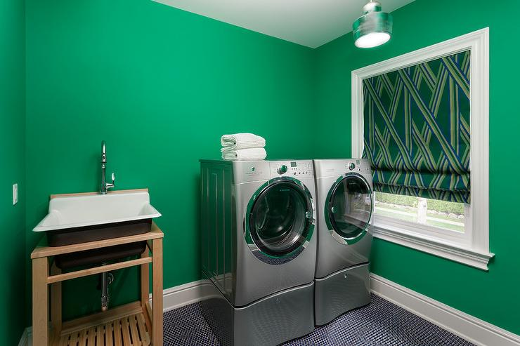 Kelly Green Laundry Room With Black Penny Tile Floor