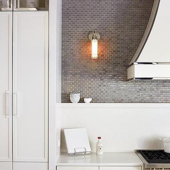 with white quartz countertops and a gray mini brick tile backsplash
