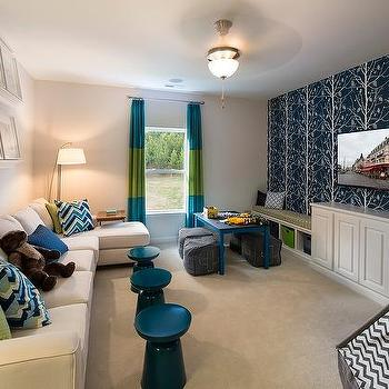Kids Playroom Family Room Ideas family room and playroom with kids art on wall - transitional
