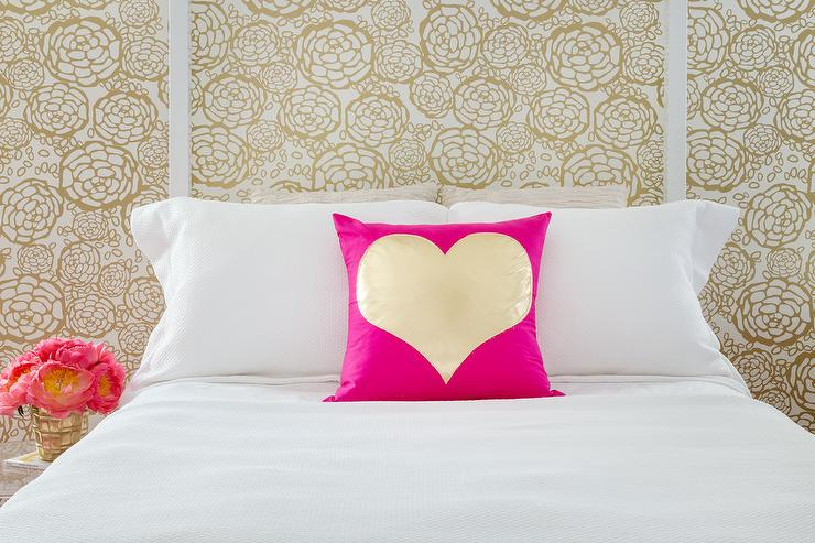 White Canopy Bed With Pink And Gold Metallic Heart Pillow