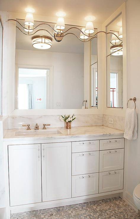 Fabulous bathroom features white cabinets adorned with nickel and lucite  pulls topped with white marble under white framed mirrors illuminated by a  wavy 3 ... - Lucite Cabinet Pulls Design Ideas