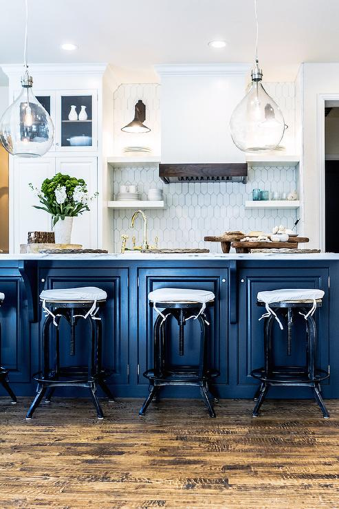 Dark metal french kitchen hood with stacked floating for Blue and white kitchen cabinets