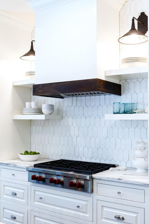white floating stove shelves with black sconces