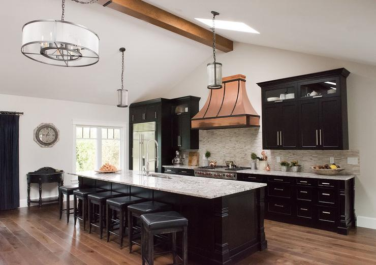 Black Kitchen Island with White and Gray Granite Countertops ...