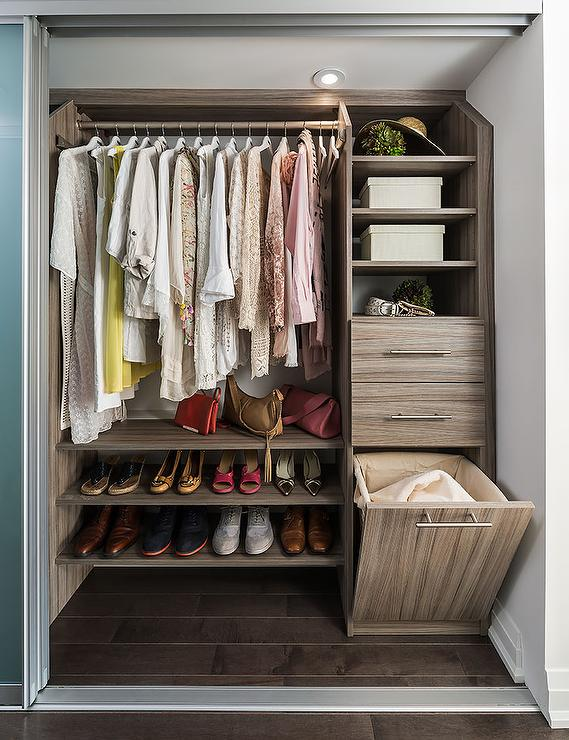 Chic Condo Closet Features A Clothes Rail Over Stacked Floating Brown  Melamine Shoe Shelves.