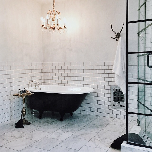 french bathroom design with black claw foot tub french