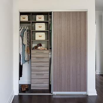 Condo closet with melamine sliding door