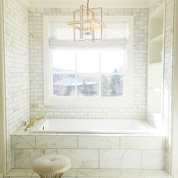 Marble Clad Tub With Brass Filler Under Chandelier