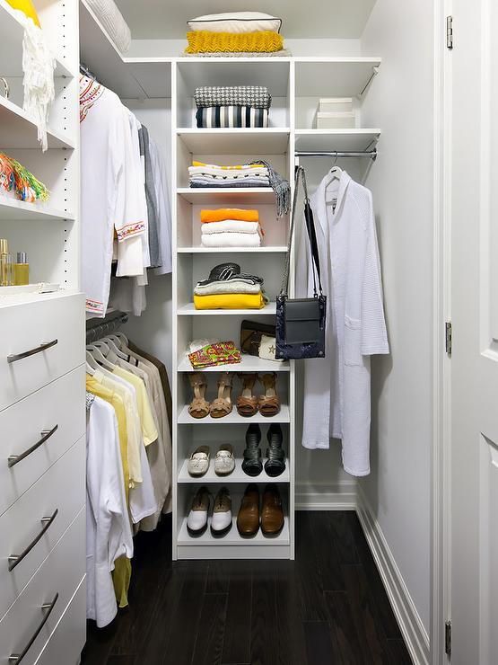 White And Yellow Closet Features White Modular Systems Fitted With Open  Shelving Over A Chest Of Lingerie Drawers Next To Stacked Clothes Rails.