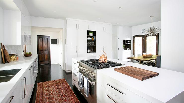 Walnut Stained Flat Front Kitchen Cabinets With White And Gold Stone