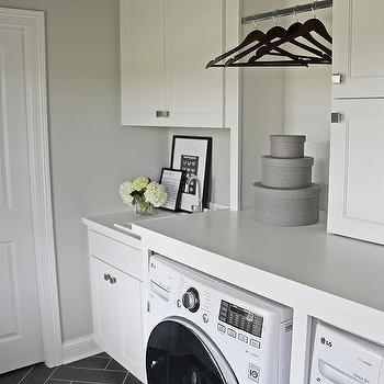 white and gray laundry room with washer and dryer facing