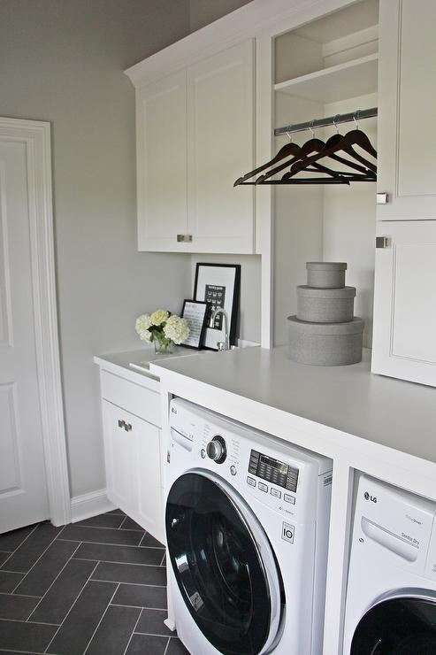 White Laundry Room With Gray Herringbone Floor Tiles Transitional