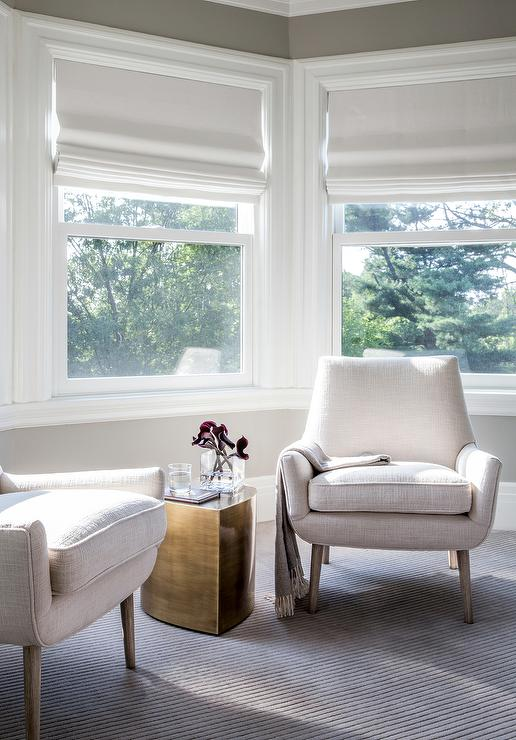 Bay Window Siiting Area With Modern White Chairs And Brass Accent Table