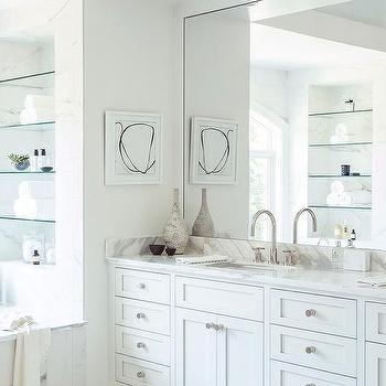 White and blue bathroom with arched tub alcove for Bathroom alcove shelves