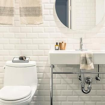 White Bathroom With Black Penny Tiles And Black Grout