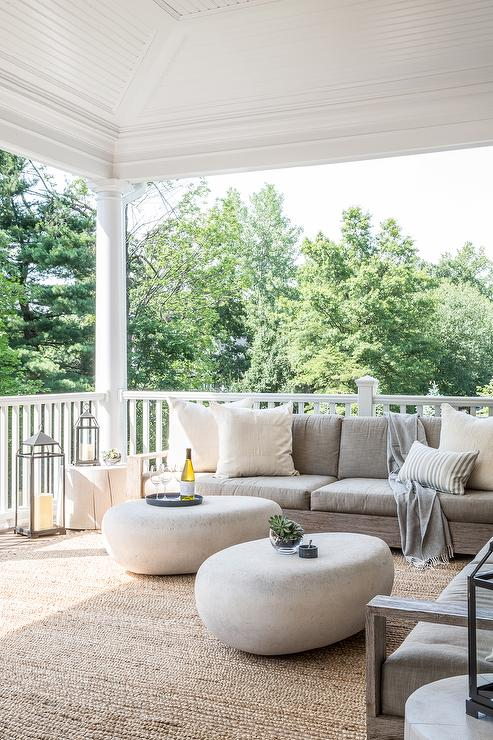 Modern Covered Patio With Low Gray Armless Outdoor Sofa