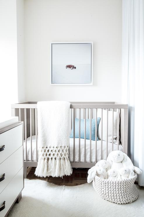 white and blue boy nursery with dwellstudio mid century