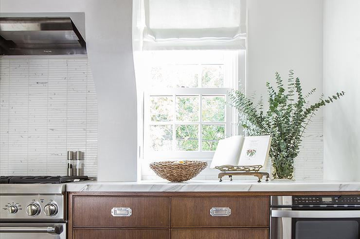 Lovely Kitchen Features Brown Cabinets Adorned With Vintage Style Pulls  Fitted With A Pull Out Microwave Next To A Stainless Stove Accented With A  Marble ...