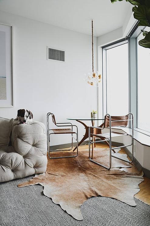 Corner Dining Space With Cowhide Rug
