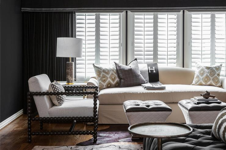 Curved Back Sofa With Black Hermes Avalon Blanket