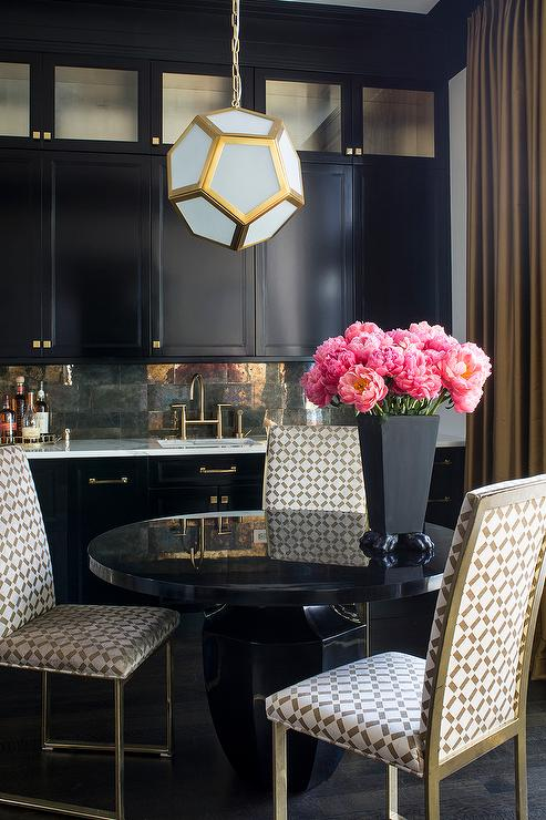 Black and gold buffet cabinet with mirrored backsplash for Dining room decorating ideas gold