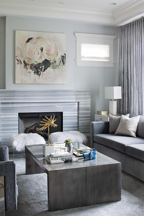 Contemporary Gray Living Room Features A Pink Rose Canvas Art Placed Above Striped Marble Fireplace Mantle
