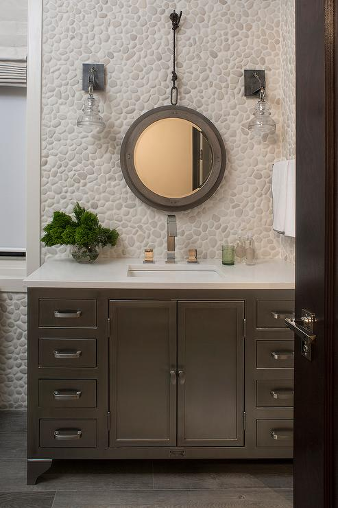 Ivory And Taupe Bathroom With River Rock Tiled Wall
