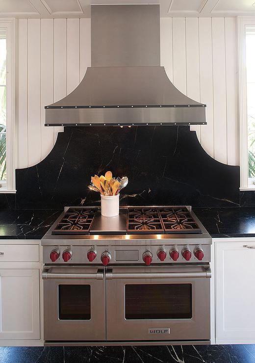 white and black kitchen backsplash tiles with wood shelves